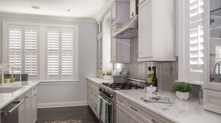 White shutters in New Brunswick kitchen with white cabinets.