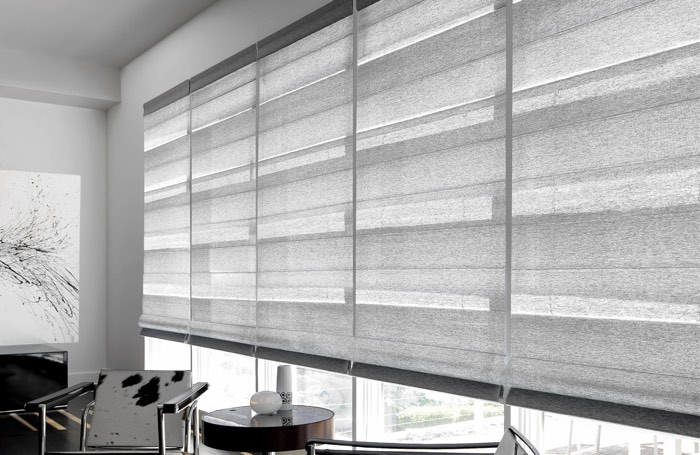 Gray shades covering large business window