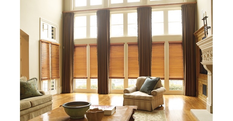 New Brunswick great room with wooden blinds and full-length draperies.