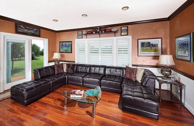 New Brunswick basement with sliding doors and plantation shutters.