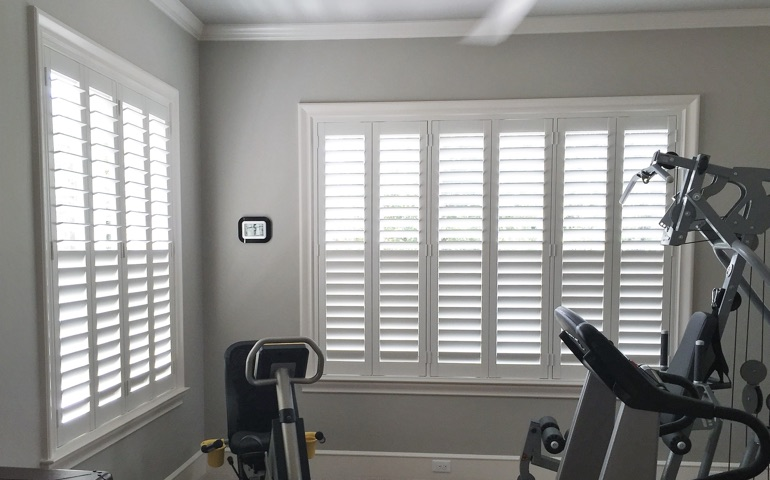 New Brunswick home gym with shuttered windows.