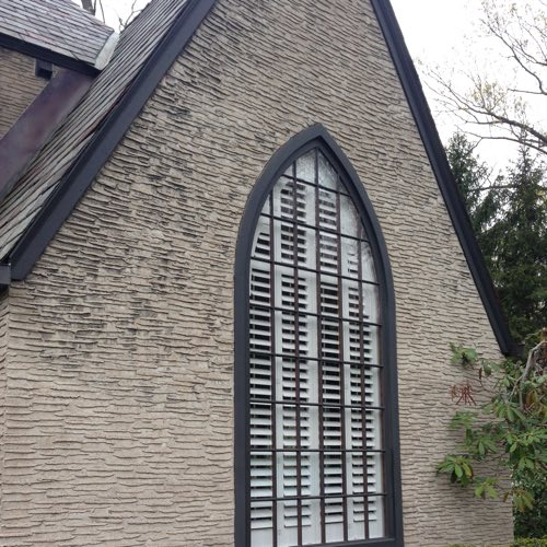 outside face of brick home with plantation shutters