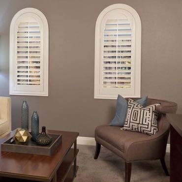 New Brunswick family room arched shutters.