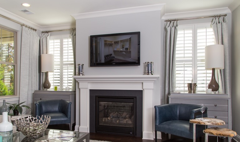 New Brunswick fireplace with plantation shutters.