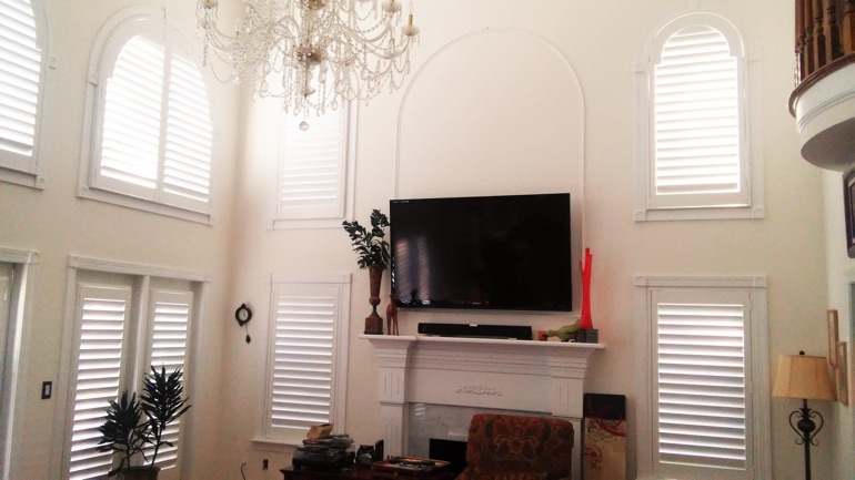 New Brunswick great room with wall-mounted television and arched windows.