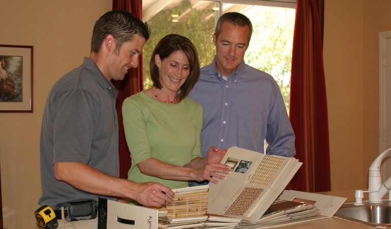 Homeowners viewing window treatment samples.