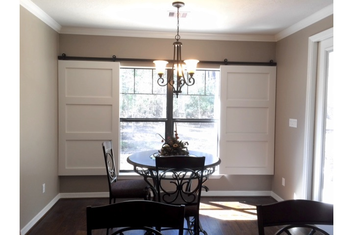 New Brunswick dining room with moveable barn door shutters.