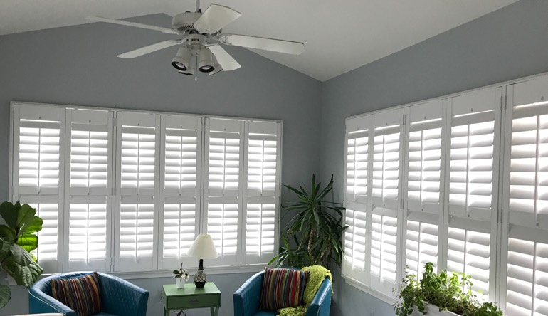 New Brunswick living room with fan and shutters