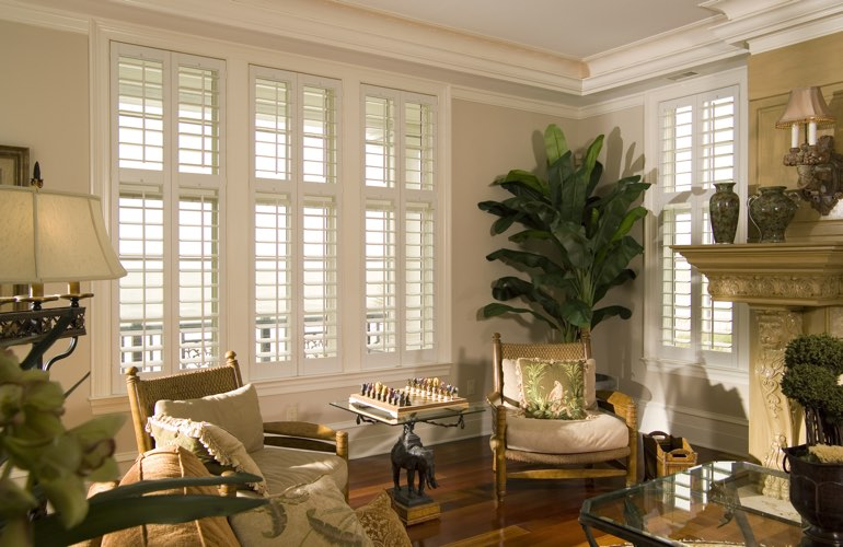 Living Room in New Brunswick with white plantation shutters.