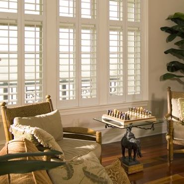 New Brunswick living room polywood shutters.