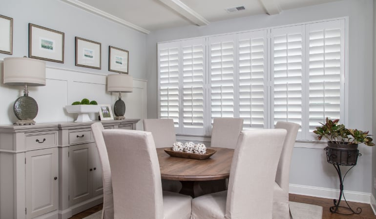 Plantation shutters in a New Brunswick dining room.