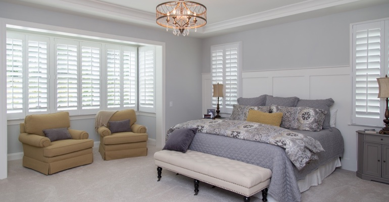 Plantation shutters in New Brunswick bedroom.