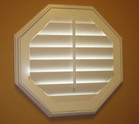 New Brunswick octagon window with white shutter