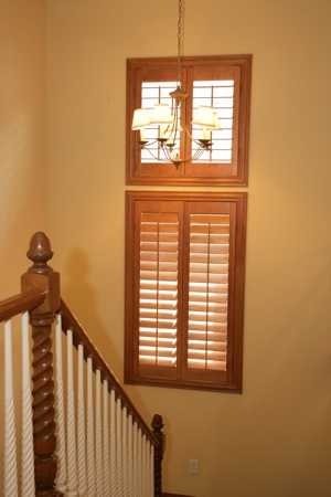 Wooden shutters in tan staircase.