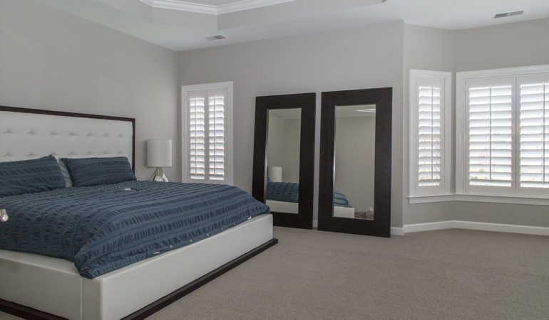 Polywood shutters in a minimalist bedroom in New Brunswick.