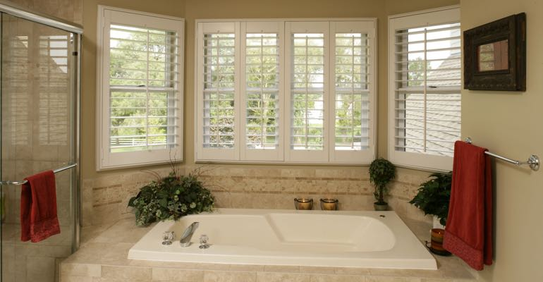 Plantation shutters in New Brunswick bathroom.