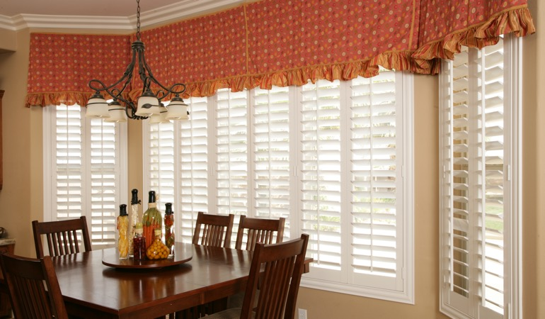 White shutters in New Brunswick dining room.