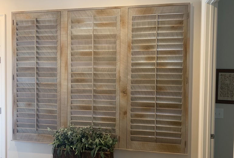 Closed reclaimed wood shutters in New Brunswick