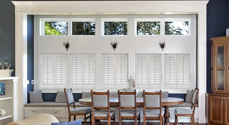 New Brunswick dining room with shut plantation shutters.