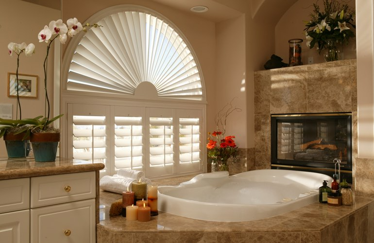 Arched shutters in a New Brunswick bathroom.