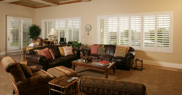 New Brunswick sunroom with polywood shutters.