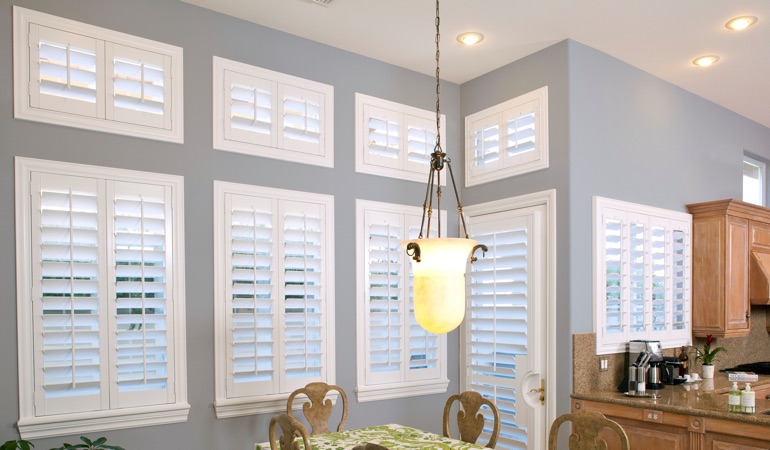 White plantation shutters in dining room