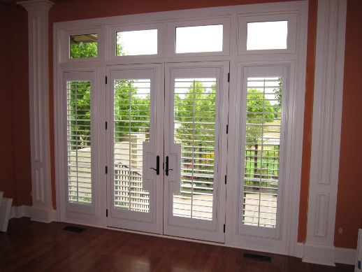 New Brunswick patio door with sidelight shutters