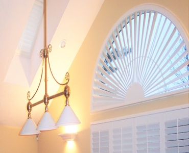 New Brunswick arched eyebrow window with white shutter