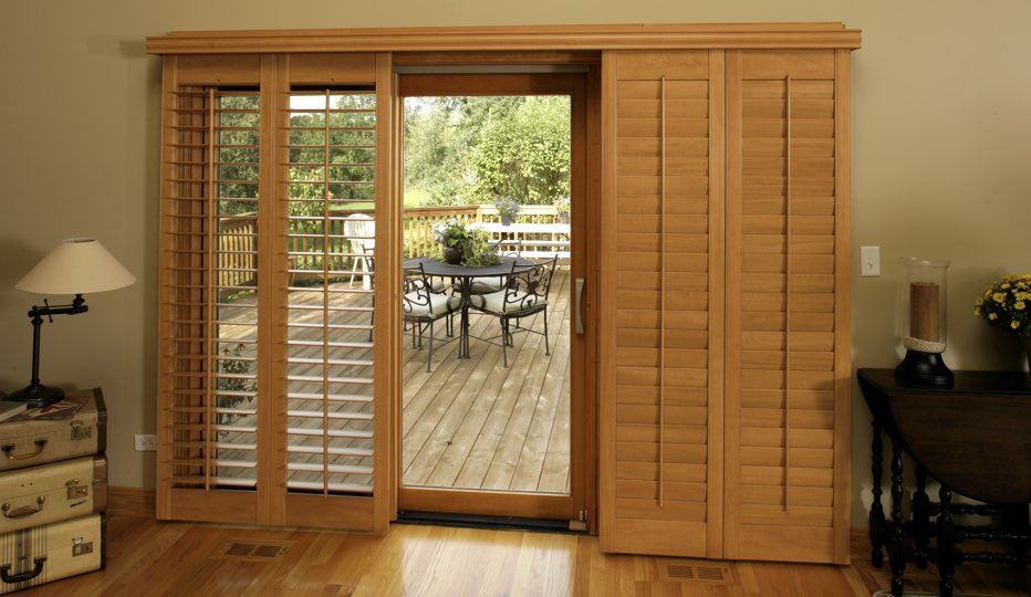 Wood bypass patio door shutters in New Brunswick living room