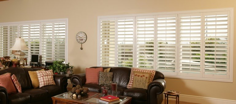 Wide window with plantation shutters in New Brunswick living room